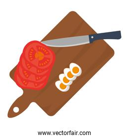 fried eggs with sliced tomato and knife inside cuttin board