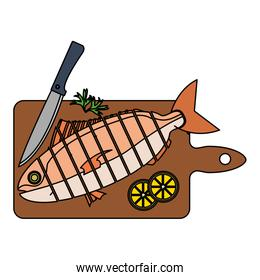 color chopped fish with lemon and knife in the cutting board