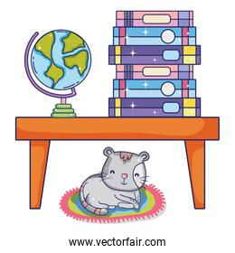 books and global desk in the table and cat