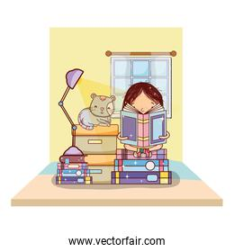 girl reading books with boxes and cat