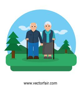 old couple with walking stick in the landscape