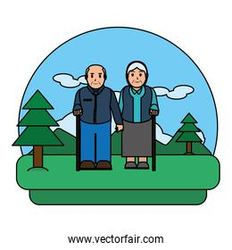 color old couple with walking stick in the landscape