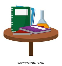 notebooks with books and erlenmeyer flask in the table