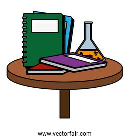color notebooks with books and erlenmeyer flask in the table