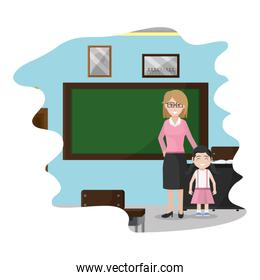 teacher with girl student in the school classroom