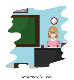 teacher sitting in her desk with book and apple