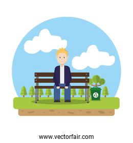 man sitting in the ecology park with recycle can