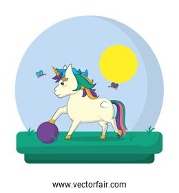 unicorn with hairstyle playing wih ball in the landscape