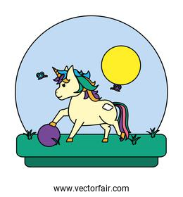 color unicorn with hairstyle playing wih ball in the landscape