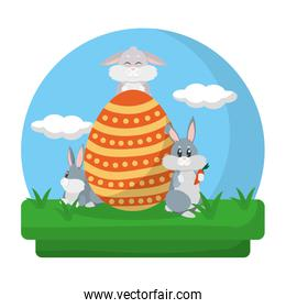 cute rabbits with egg easter decoration