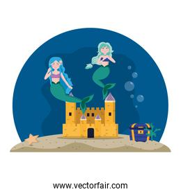nice mermaids under water with castle and coffer