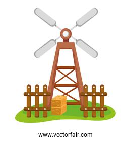 nature windmill with wood grillage and straw bale