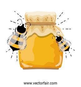 crystal glass with delicious honey and bees