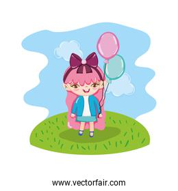 nice girl child with balloons in the landscape