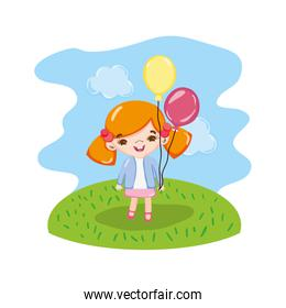 girl child with funny balloons in the landscape
