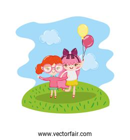 girls children with nice balloons in the landscape