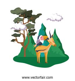 cute bird toucan with deer in the landscape