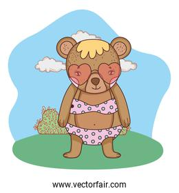 cute little bear with heart sunglasses in the camp