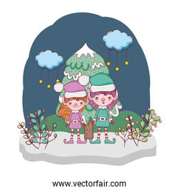 cute santa helpers couple in the snowscape