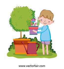 boy lifting houseplant with sprinkler and tree