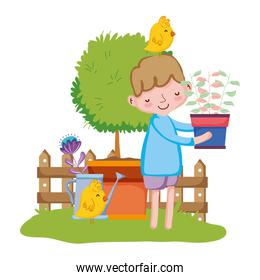 little boy lifting houseplant with chick