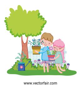 little kids couple lifting houseplant with fence in the garden
