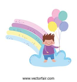 little chubby boy with rainbow and balloons helium