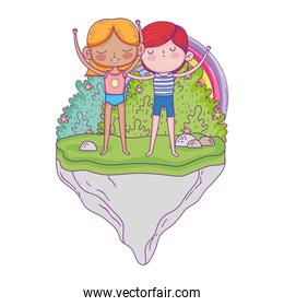 little kids couple in the garden with rainbow