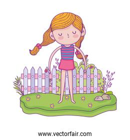 little girl in the garden with flowers