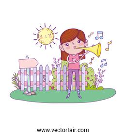cute little girl playing trumpet in the landscape