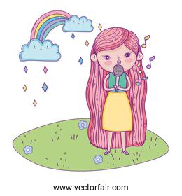 girl singing with microphone in the landscape and rainbow