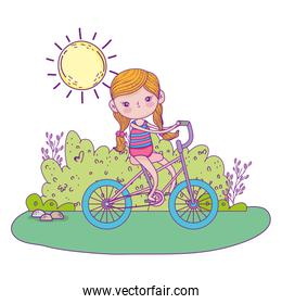 cute little girl riding bicycle in the landscape
