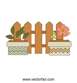 wooden fence with flowers and plant in ceramic pots