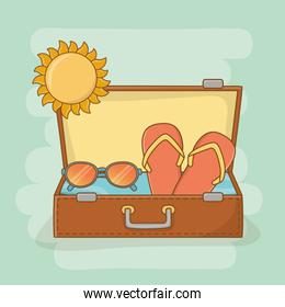 suitcase bag with travel vacations items