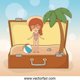 young girl in suitcase on the beach scene