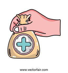hand with bag dotation with heart and cross symbol