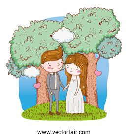 woman and man wedding with clouds and trees