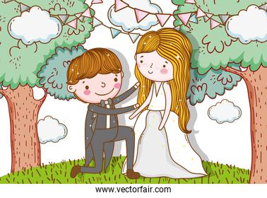 man and woman with party flags in the trees