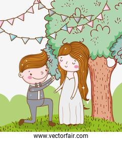 man and woman wedding with party flags and tree