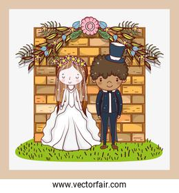 woman and man with brick wall and flowers plants