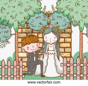 woman and man wedding with fence and trees