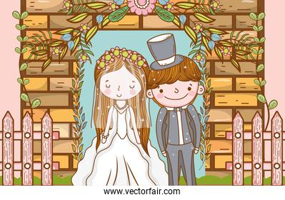 woman and man with fence and brick wall