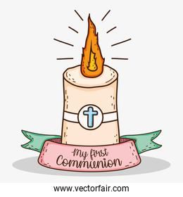 candle with cross and ribbon to tradition first communion