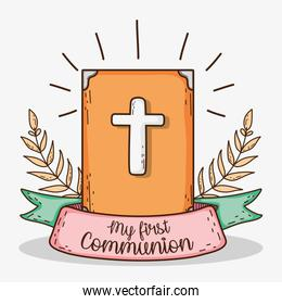 bible with branches leaves and ribbon to first communion