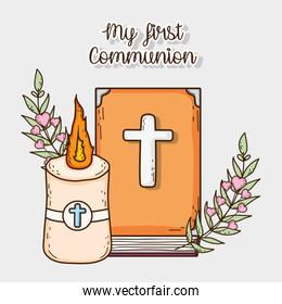 bible with candle and cross to first communion