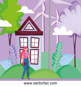 woman with house and turbine wind energy ecology