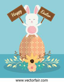 cute rabbit with easter egg painted and flowers