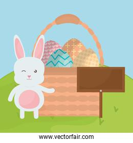 cute rabbit with easter eggs painted in basket