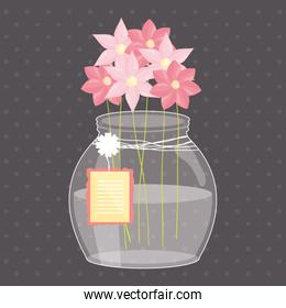 mason jar glass with flowers and tag hanging
