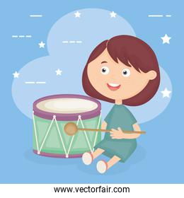 little girl playing with drum instrument